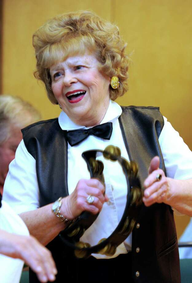 Dolores Morgenthaler, 77, sings and plays the tambourine during a rehearsal of the Silver Tones at Elmwood Hall, Danbury's senior center, Tuesday, May 15, 2012. Photo: Carol Kaliff / The News-Times