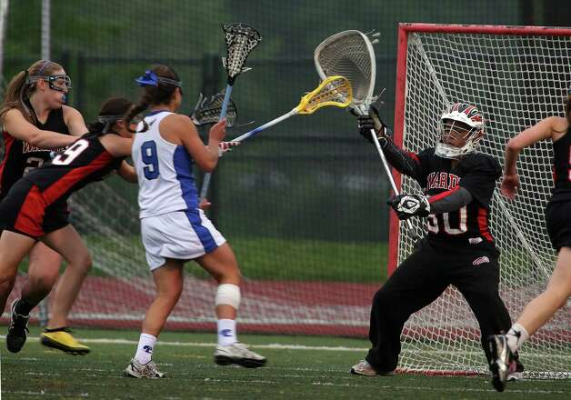 Fairfield Warde goalie #30 Jahzmin Howell looks to protect her goal during first period action  in the crosstown lacrosse matchup against Fairfield Ludlowe High School on Tuesday, May 15, 2012. Fairfield Ludlowe High School won the contest 15-3. Photo: Mike Ross / Connecticut Post Freelance © www.mikerossphoto.com