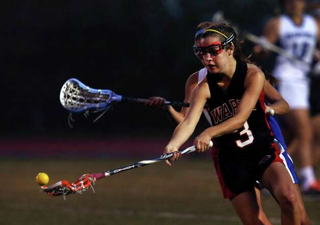 Fairfield Warde #3 Caroline Lamber steals the ball while defending against Fairfield Ludlowe High School in the crosstown lacrosse matchup on Tuesday, May 15, 2012. Fairfield Ludlowe High School won the contest 15-3.. Ludlowe would win 15-3. Photo: Mike Ross / Connecticut Post Freelance © www.mikerossphoto.com