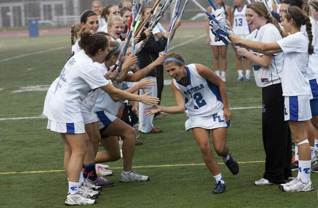 Fairfield Ludlowe Senior #12 Mary Deliberti is congratulated by lacrosse teamates during Senior day prior to the start of Tuesday evening match up against Fairfield Warde on Tuesday, May 15, 2012. Fairfield Ludlowe High School won the contest 15-3. Photo: Mike Ross / Connecticut Post Freelance © www.mikerossphoto.com