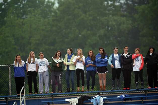 Fairfield Ludlowe High School students cheer on their school team during the crosstown lacrosse matchup on Tuesday, May 15, 2012. Fairfield Ludlowe High School won the contest 15-3. Photo: Mike Ross / Connecticut Post Freelance © www.mikerossphoto.com
