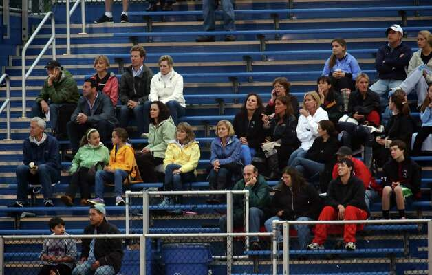 The crowd watches in the crosstown girls lacrosse matchup between Fairfield Warde and Fairfield Ludlowe High School on Tuesday, May 15, 2012. Fairfield Ludlowe High School won the contest 15-3. Photo: Mike Ross / Connecticut Post Freelance © www.mikerossphoto.com