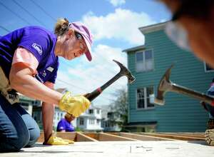 Habitat for Humanities volunteer, Lorrie Stapleton, of Old Greenwich, works on a construction site at 65 Whittier Street in Bridgeport Thursday, May 10, 2012.