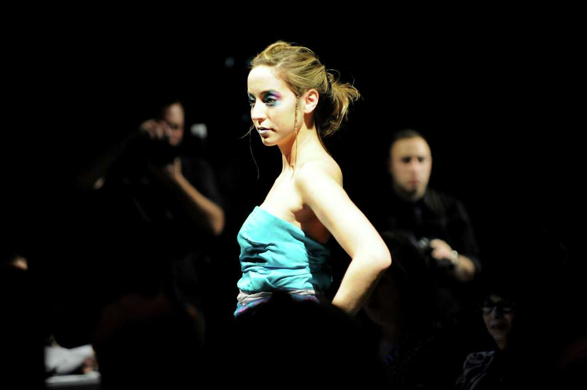 Kelsey Schmidt models the Layer Cake dress designed by Rana Fayez during the Electric City Courture fashion show on Friday, May 20, 2011, at Proctors in Schenectady, N.Y. (Cindy Schultz / Times Union)