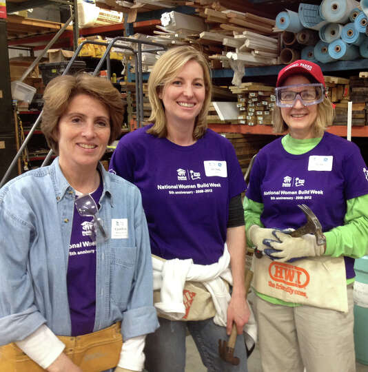 Cynthia Blumenthal, left, wife of Senator Richard Blumenthal, with GE volunteers, Michelle Reeve, ce