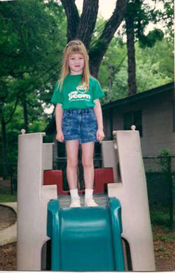 THEN: Caroline Howard stands atop her favorite slide at the Acorn School on Broadway in May 1999