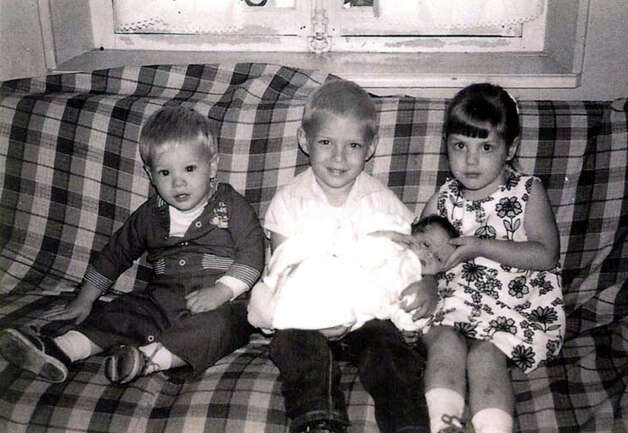 THEN: Siblings Roger (from left) Chuck, Jeani and Randy Olson in 1964 Photo: Dick, COURTESY
