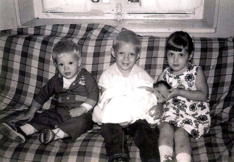 THEN: Siblings Roger (from left) Chuck, Jeani and Randy Olson in 1964