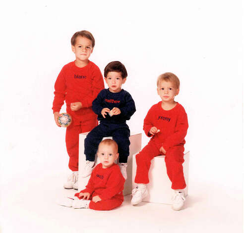THEN: Brothers and cousin (Back L-R) Blaine Ingram, Matthew Kusek, Jeremy Ingram; Floor: Austin Ingram, Sept. 1988. Photo: COURTESY
