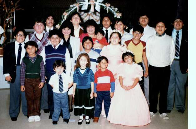 The 1985 wedding of Teresa Campa (former Carranza) at El Conquistador Ballroom.  The oldest person in the picture is Albert J. Cerna (last row left side); the youngest is Johnny Carranza (baby being held). Photo: COURTESY