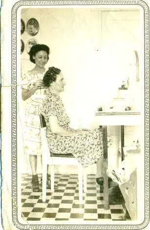 THEN: Hairdresser Sarah Duran Lopez in a salon at 721 N. Alamo Street on corner of 8th Street in 1938. Customer's name is unknown. Photo: COURTESY