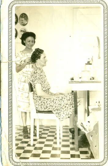 THEN: Hairdresser Sarah Duran Lopez in a salon at 721 N. Alamo Street on corner of 8th Street in 193