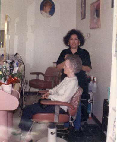 NOW: Hairdresser Bertha Lopez Pena (Sarah Duran's daughter) at a salon at 1831 S. Gen. McMullen in 1993. Customer's name is Agnes Brown. Photo: COURTESY