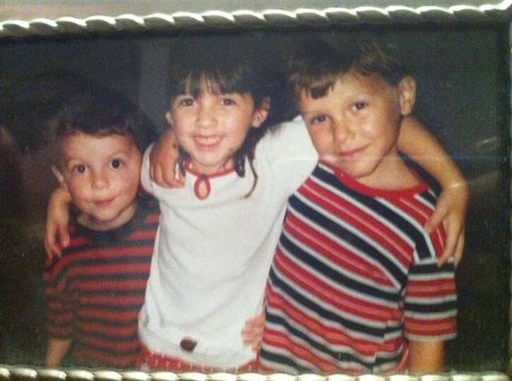 THEN: Cousins Bryce Biediger (from left), 5, Kaelin Biediger, 6, and Jeff Camp, 6, in 2003.