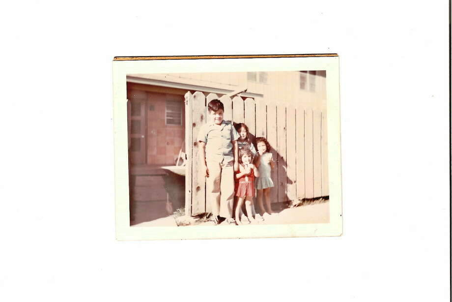 THEN: Siblings Mario (clockwise from left), Carmela, Marcelina and Barbara Flores. in 1970 Photo: COURTESY