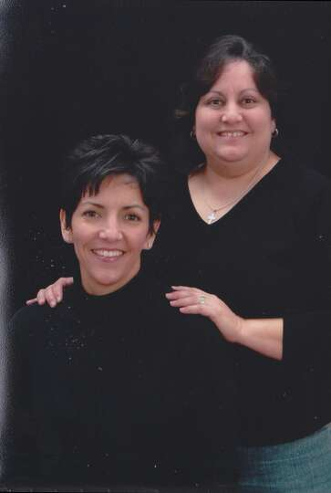 NOW: Yvonne Galindo (standing), 44, and Michelle Galindo Russi, 42,  2006.