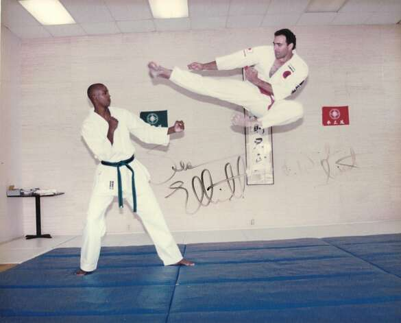 THEN: Winslow Swart, 34,  performs a Kenseido flying side kick with San Antonio Spur forward Sean Elliott in 1994 Photo: COURTESY