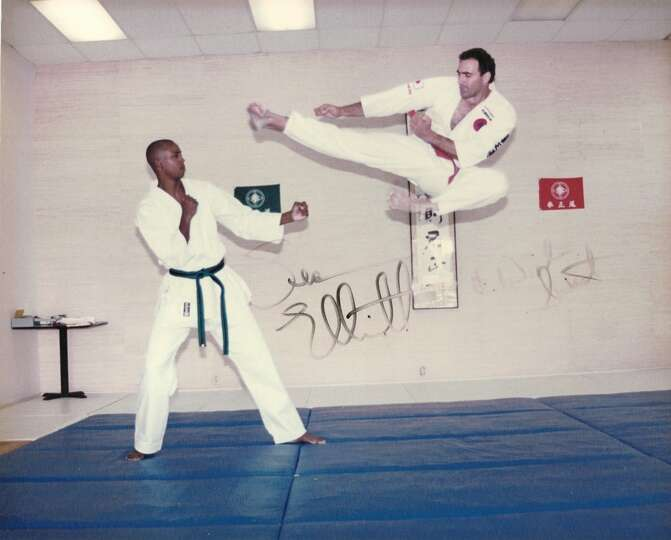 THEN: Winslow Swart, 34,  performs a Kenseido flying side kick with San Antonio Spur forward Sean El
