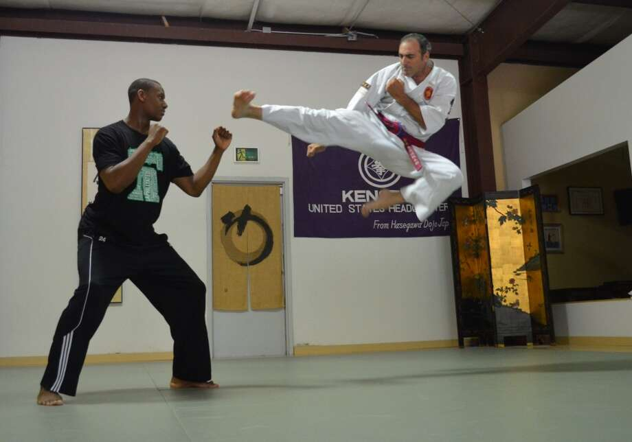 Now:Winslow Swart, 52,  performs a Kenseido flying side kick with Philadelphia 76er Lavoy Allen in 2012 Photo: COURTESY
