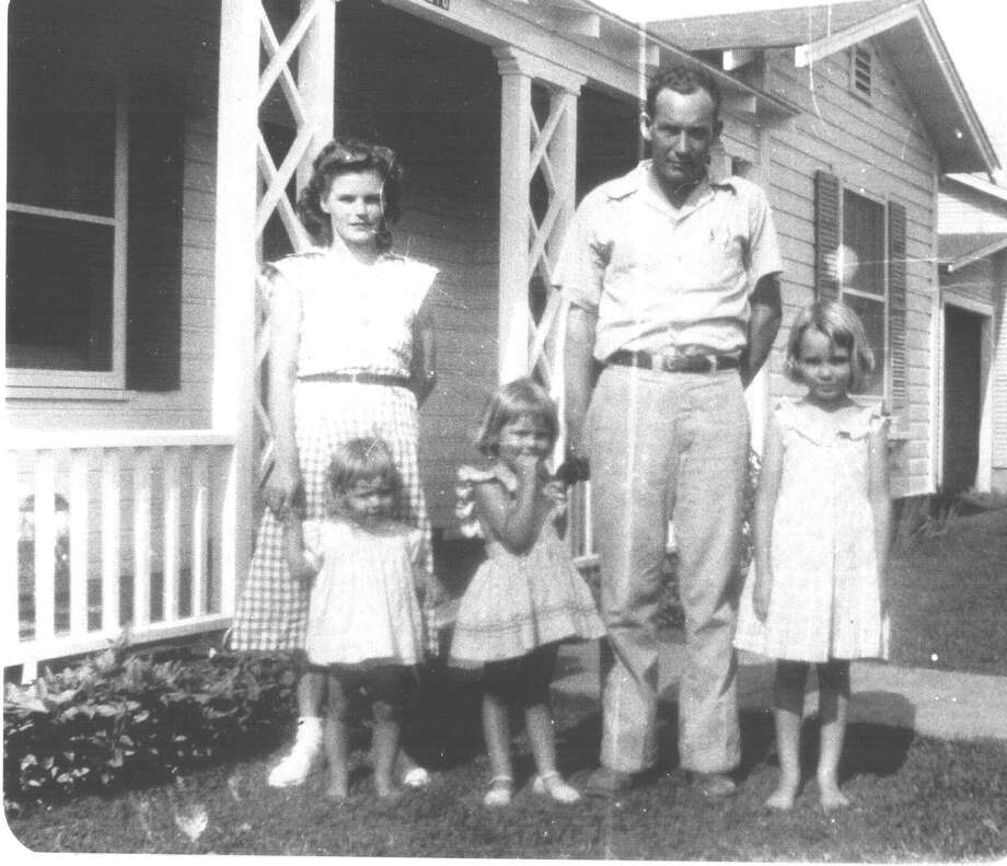 Then: 1949, Emma and Lawrence Saunders (both now deceased) and their daughters Kathy, Doreene, and Allene stand in front of the house Lawrence Saunders built on Oppenheimer Street in Uvalde. Photo: COURTESY