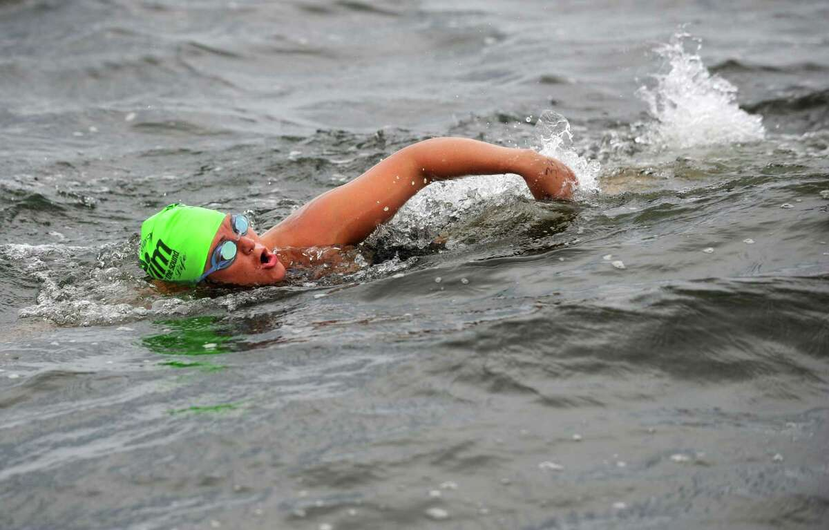 Tracie Shock, of Milford, CT, participates in the 24th Annual SWIM Across the Sound Marathon Saturday, August 6, 2011. Schock made the 15.5 mile journey across the Long Island Sound with Team Seagurls. Their group was inspired by Lindsay Robillard, of New Haven, who lost her father to cancer in May.