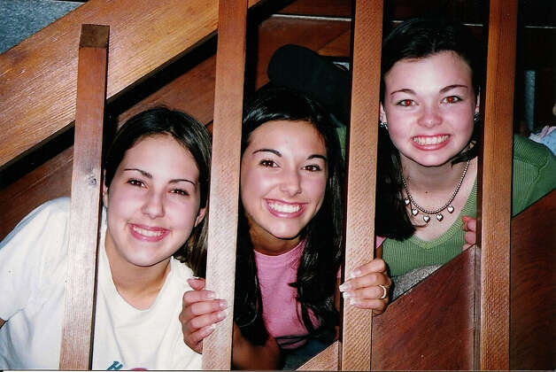 NOW: Richardson says she often re-created favorite photos of her grandchildren and so in 2002 the girls, in their teens at the time, again posed on the stairway their grandmother's home - this time sans face paint. Leslie (from left), Magen and Maggie Richardson in 2012 Photo: COURTESY