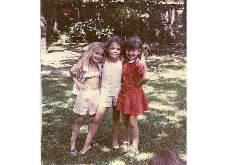 THEN: 1986, in grandma's backyard, Arlington. Cousins Cassie Merz, Rachael Gomez and Heather Collins