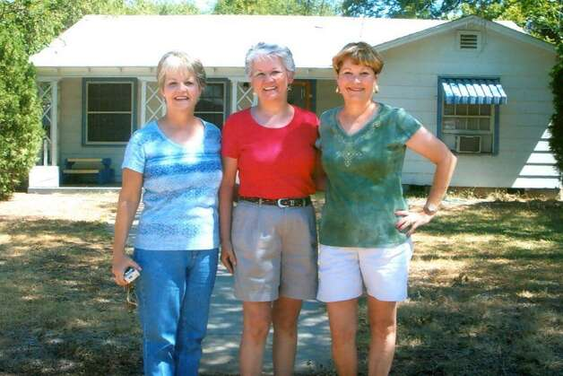 THEN: 2009. Kathy Bortz, Doreene Barrett and Allene Mandry visit the house their father, Lawrence Saunders (now deceased) built on Oppenheimer Street in Uvalde. Photo: Picasa, COURTESY