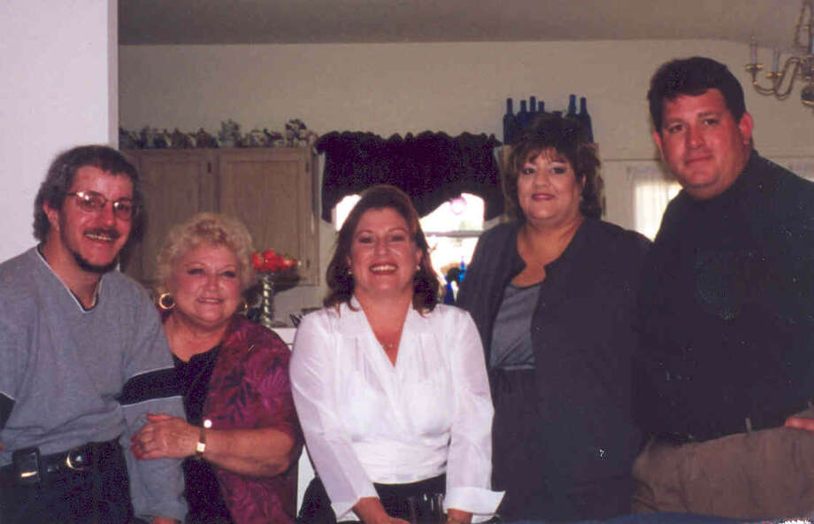 NOW: 2005, San Antonio. Mary Mora, 65, with her children, David Mora, 39, Anne Dacy, 44, Irene Lodge, 42, and Joseito, 43. Anne lives in Boerne and is an Associate Partner with IBM. Irene is an area Sales Manager for Drury Inns & Suites,and David is an Anesthesia Tech at University Hospital in San Antonio. Joseito lives in Tampa, FL and is Vice President of Studio fs, an architectural design company. Mary is soon to retire From Northside ISD as a Coordinator for Adult & Community Education. Photo: COURTESY
