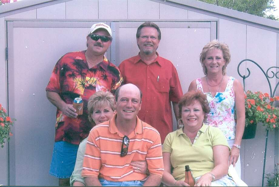 NOW: 2010. Siblings (Top L to R) Preston Vest, Gary Vest and Chris Trapolino.  (Bottom L to R), Terri Clark holds Bill Vest, and next to them is Cheryl Hurst. Photo: COURTESY