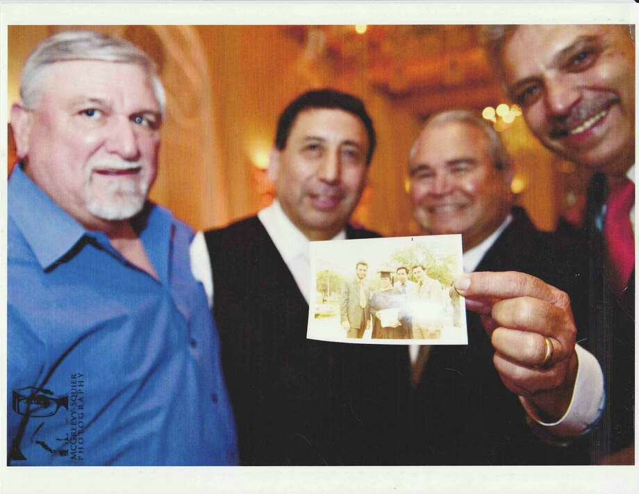 Now:2012. (L to R) Rudy Ruiz, Frank Pena, John Trevino and Jesse DeLa Rosa. hold a photo of themselves from May, 1970 showing John Trevino's graduation from Our Lady of the Lake University. In the smaller photo, from left, are Jesse DeLa Rosa, John Trevino, Frank Pena, and Rudy Ruiz. Photo: COURTESY