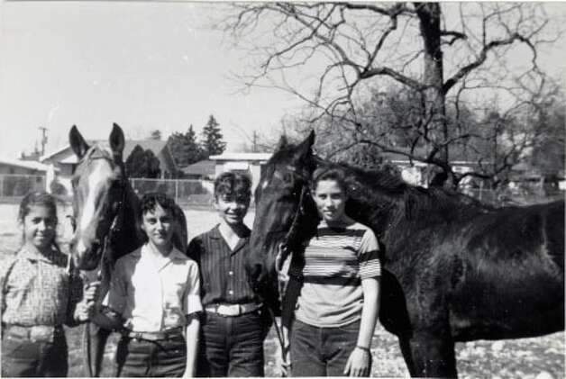 THEN: 1961, Ft. Sam Houston, Boots and Saddles Club. (From left) Dudley Spearman, Carol Darling, Jackie Snyder, Sharron Scott. Photo: COURTESY