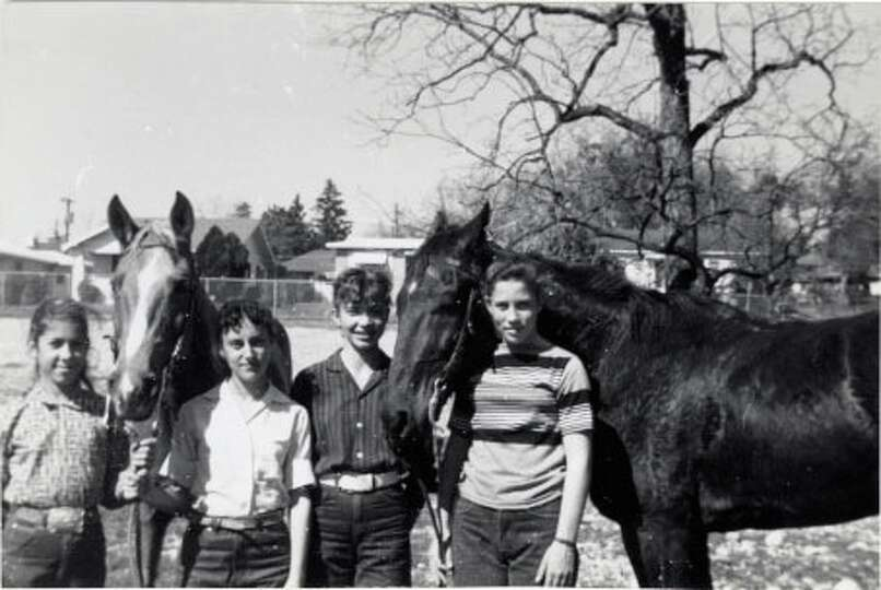 THEN: 1961, Ft. Sam Houston, Boots and Saddles Club. (From left) Dudley Spearman, Carol Darling, Jac