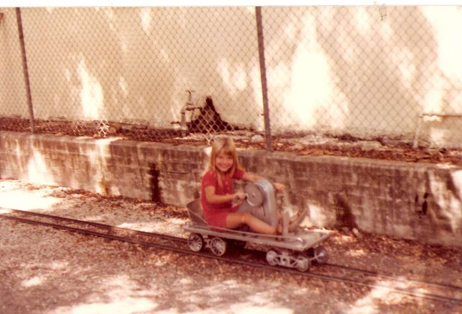 Then: 1983, the Kiddie Park on Broadway. Becky Grimes (daughter of George Grimes) age 6. Photo: COURTESY