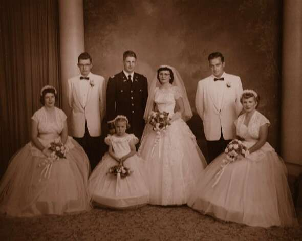 THEN: Don & June Graesser, original wedding portrait June 1956 in Wisconsin. The bride and groom are June (Atkins) and Don Graesser. From left on the original photo are Patricia (Graesser) Stommel, Al Atkins, flower girl Marilyn (Keehn) Bailey, Eugene Stommel, and Marie (Atkins) Jensen. Photo: COURTESY