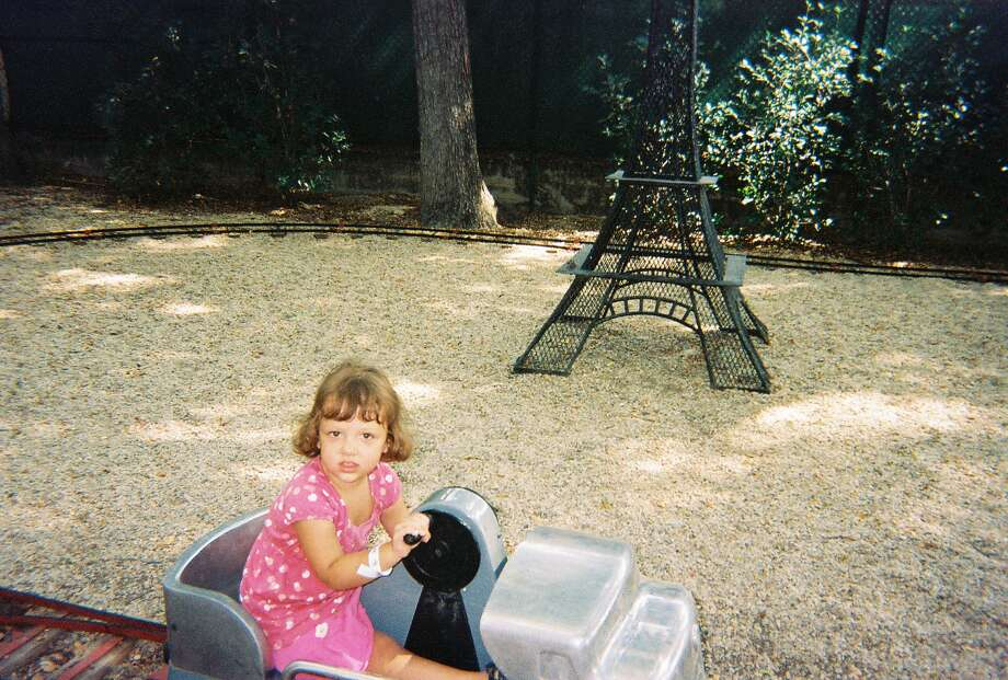 Now:2012, Kiddie Park on Broadway. Lily Rain Rain Grimes granddaughter of George Grimes, age 4. Photo: COURTESY