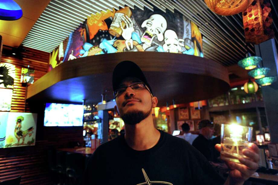 "Oscar Chavarria, who works at the County Line restaurant, is a muralist who painted a work he calls ""Good Times"" at the Barriba Cantina in San Antonio. Photo: Billy Calzada, San Antonio Express-News / SAN ANTONIO EXPRESS-NEWS"