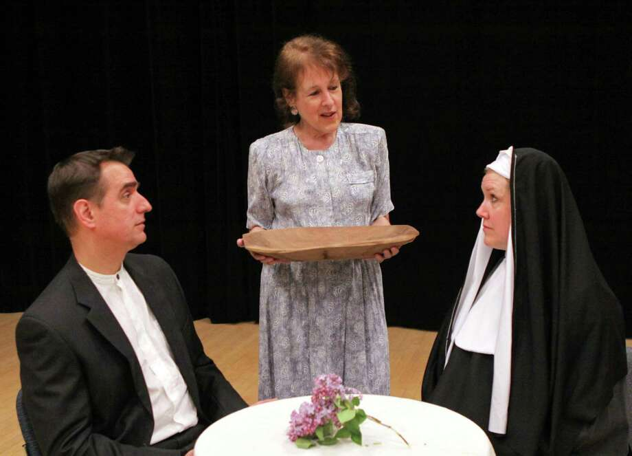 "Richard Warren (Milford) as Father Rivard, Barbara Lencheck (Norwalk) as Mrs. Shandig and Kate Telfer (Greenwich) as Sister Rita in the Darien Players' play ""The Runner Stumbles,"" which will conclude its run this weekend. Photo: Contributed Photo / Darien News"