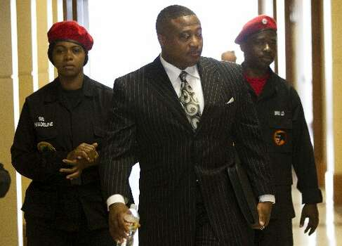 Activist Quanell X arrives for the trial against former Houston police officer Andrew Blomberg Wednesday, May 16, 2012, in Houston. Blomberg is on trial for official oppression in the video taped 2010 beating of 15-year-old Chad Holley. ( Brett Coomer / Houston Chronicle )