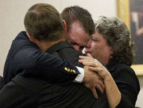 Former Houston police officer Andrew Blomberg embraces his parents as they react to him being found innocent of the charge of official oppression in a Harris County court Wednesday, May 16, 2012, in Houston. Blomberg was on trial for official oppression in the video taped 2010 beating of 15-year-old Chad Holley. ( Brett Coomer / Houston Chronicle )