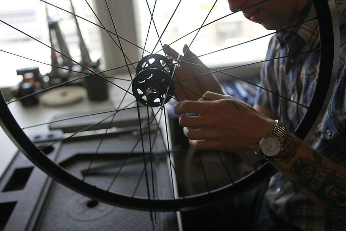 Builder, James Bringman works on a bike at Mission Bicycle Company which specializes in fixed gear bikes in San Francisco, Calif., on Tuesday, May 1st , 2012.