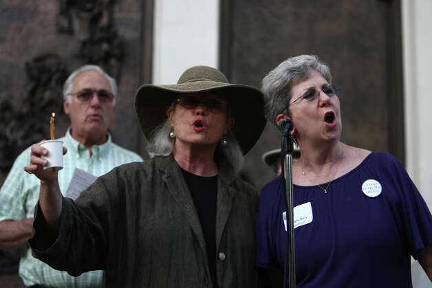 MHB Conant, left, and Gretchen Gundrum sing during a vigil offering support for Catholic nuns. Photo: JOSHUA TRUJILLO / SEATTLEPI.COM