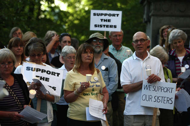 People gather during a vigil offering support for Catholic nuns. Photo: JOSHUA TRUJILLO / SEATTLEPI.COM