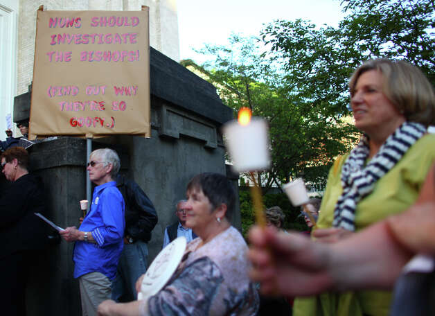 People gather during a vigil offering support for Catholic nuns at St. James Cathedral in Seattle. Photo: JOSHUA TRUJILLO / SEATTLEPI.COM
