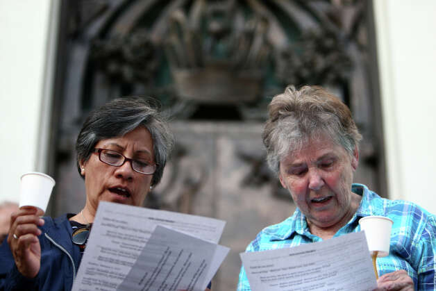 "Dominican Order Sisters Teresa Montes, left, and Phyllis Kelleher sing during a vigil offering support for Catholic nuns on Tuesday, May 15, 2012 at St. James Cathedral in Seattle. Seattle Archbishop Peter Sartain has been appointed by the Pope to impose discipline on American nuns that the Vatican says sometimes promote ""radical feminist themes incompatible with the Catholic Faith."" Photo: JOSHUA TRUJILLO / SEATTLEPI.COM"