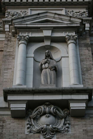"A statue of Mother Cabrini is shown on the St. James Cathedral during a vigil offering support for Catholic nuns. Seattle Archbishop Peter Sartain has been appointed by the Pope to impose discipline on American nuns that the Vatican says sometimes promote ""radical feminist themes incompatible with the Catholic Faith."" Photo: JOSHUA TRUJILLO / SEATTLEPI.COM"