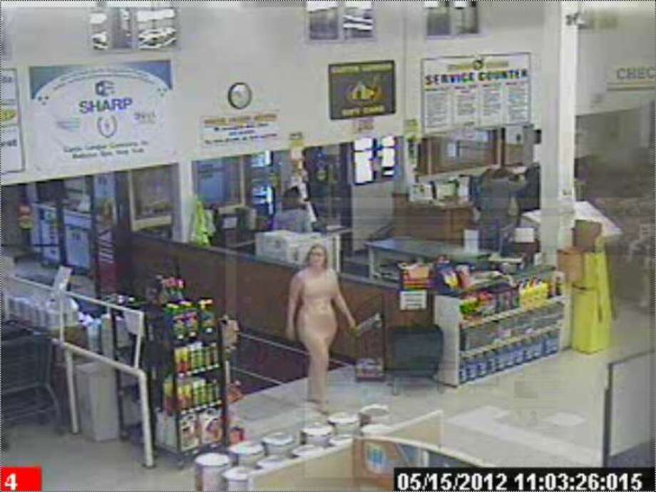 A photo of a woman that is being shared on Facebook shows a naked woman entering the Curtis Lumber in Ballston on Tuesday, May 15, 2012. The Times Union obtained this photo which was already altered to obscure parts of her body.