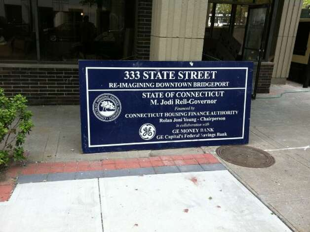 The sign designating the state funding for the renovation of 333 State sits on the ground outside the building May 15, 2012 (Rob Varnon)