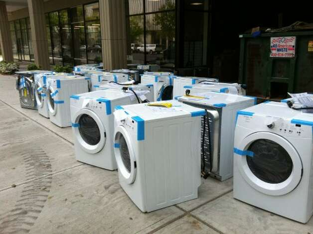 Washing machines await to be whisked upstairs into new apartments at 333 State St. on May 15 (Rob Varnon)