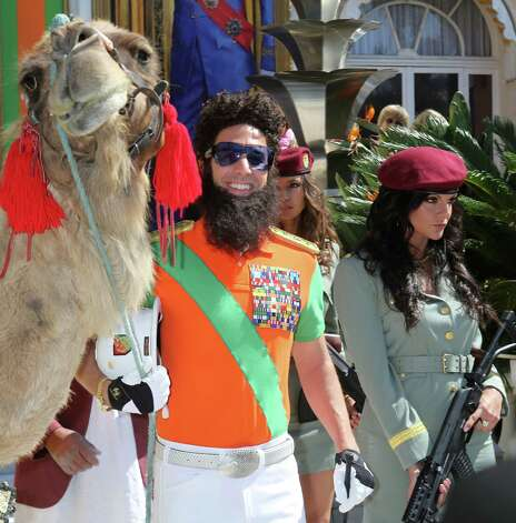 "British actor Sacha Baron Cohen dressed as Admiral General Aladeen poses with a camel during a photocall to promote the film ""The Dictator"" in front of the Carlton Hotel at the 65th Cannes film festival on May 16, 2012 in Cannes.                  AFP PHOTO / LOIC VENANCE        (Photo credit should read LOIC VENANCE/AFP/GettyImages) Photo: LOIC VENANCE, AFP/Getty Images / 2012 AFP"